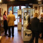 "Visitors enjoying the displays from our ""Wearing the Trousers"" exhibition in 2009 which illustrated the link between fashion and women's role in society through the ages."