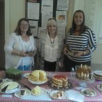 The winner (Victoria Morgan, pictured right) and runner-up (Sue Hirons, pictured left) in the 2016 Bake-off with their trophies, awarded by Cllr Christina Duncan