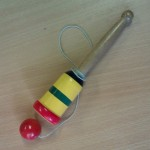 Cup & Ball - this is an example of a penny toy, simple wooden toys so-called because they would only have cost one penny. The object of the game is to flip the ball up into the air and catch it in the cup. It sounds easy, but it's quite tricky - and very addictive!