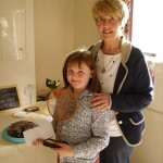 Winner of the Great Eccleston Bake-off 2013, 8 year old Mary Jane Duffy. Her Cheeky Chocolate Cake wowed judge Teresa Sims, Chair of Eccleston Parish Council, also pictured.