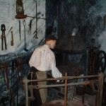 """Bob"" the blacksmith hard at work on our model forge"
