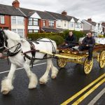 Puzzle the Horse en route to the Smithy pulling a dray filled with barrels of ale from George Wright's Brewery for International Blacksmiths Day 2016