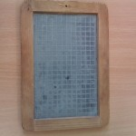 Slate - this one is double-sided, with a plain side and a gridded side, used for arithmatic.